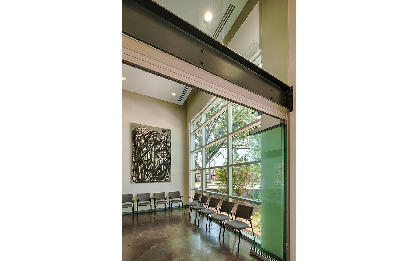 Milton Rhodes Center for the Arts Interior with large window and chaires