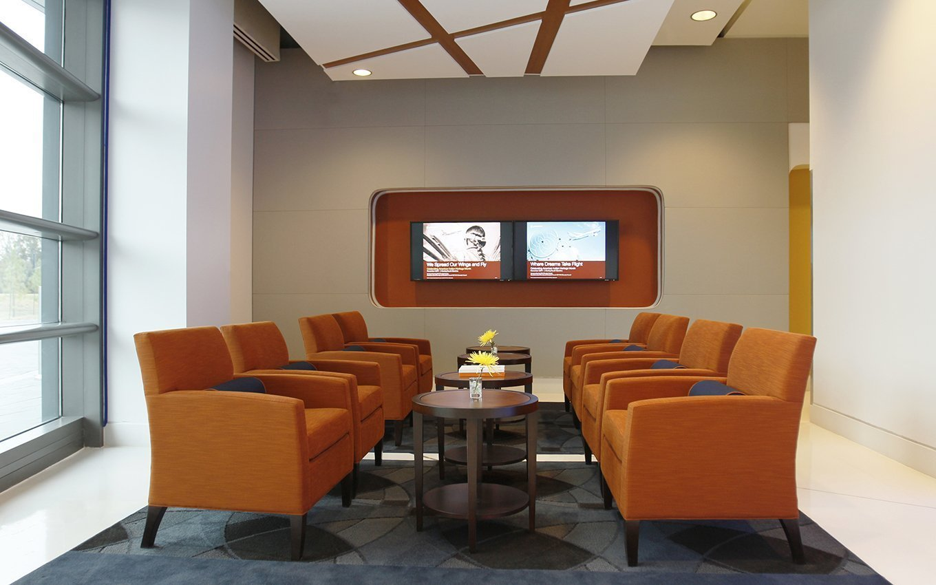 Boeing Welcome Center Seating Area with 8 orange upholstered chairs