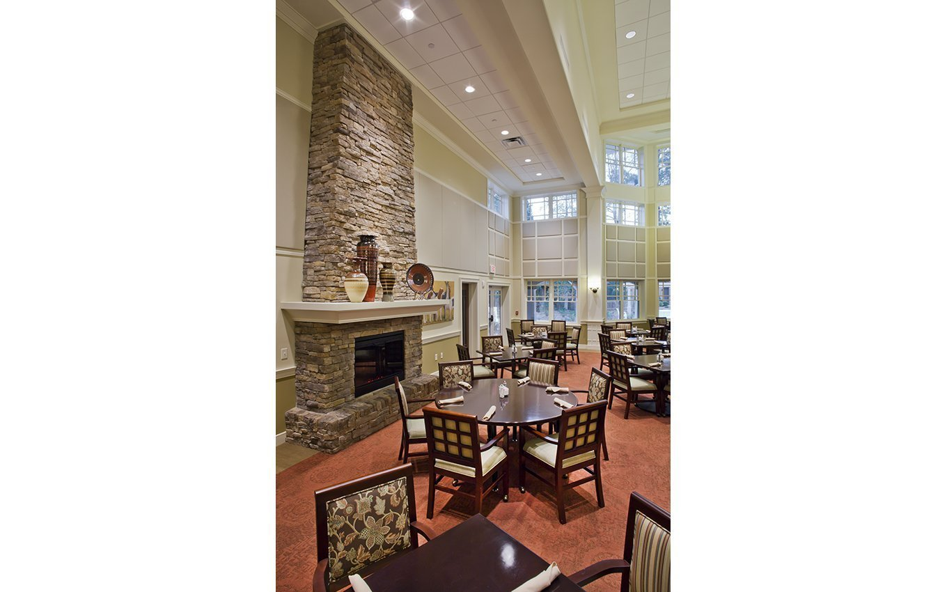 Penick Village Dining Room with fireplace and high ceiling