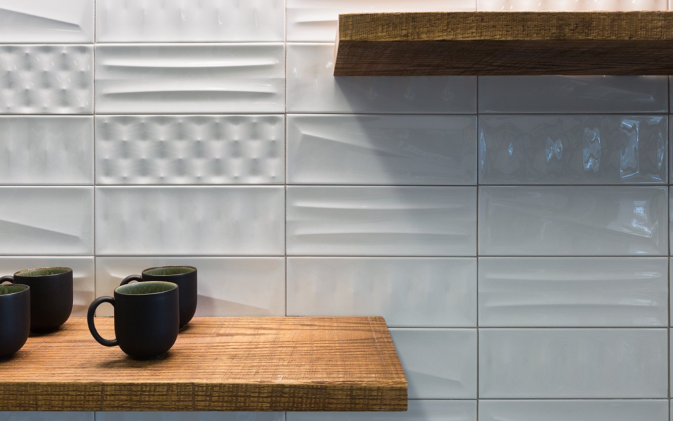 525@vine Kitchen Details, close up of white tiles and floating wood shelving with cups