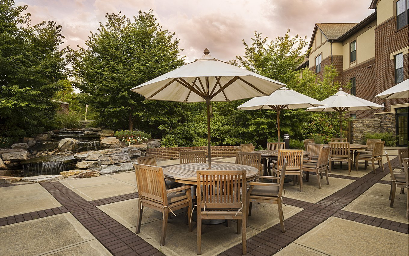 Danberry at Inverness outdoor dining with tables/umbrellas and chairs