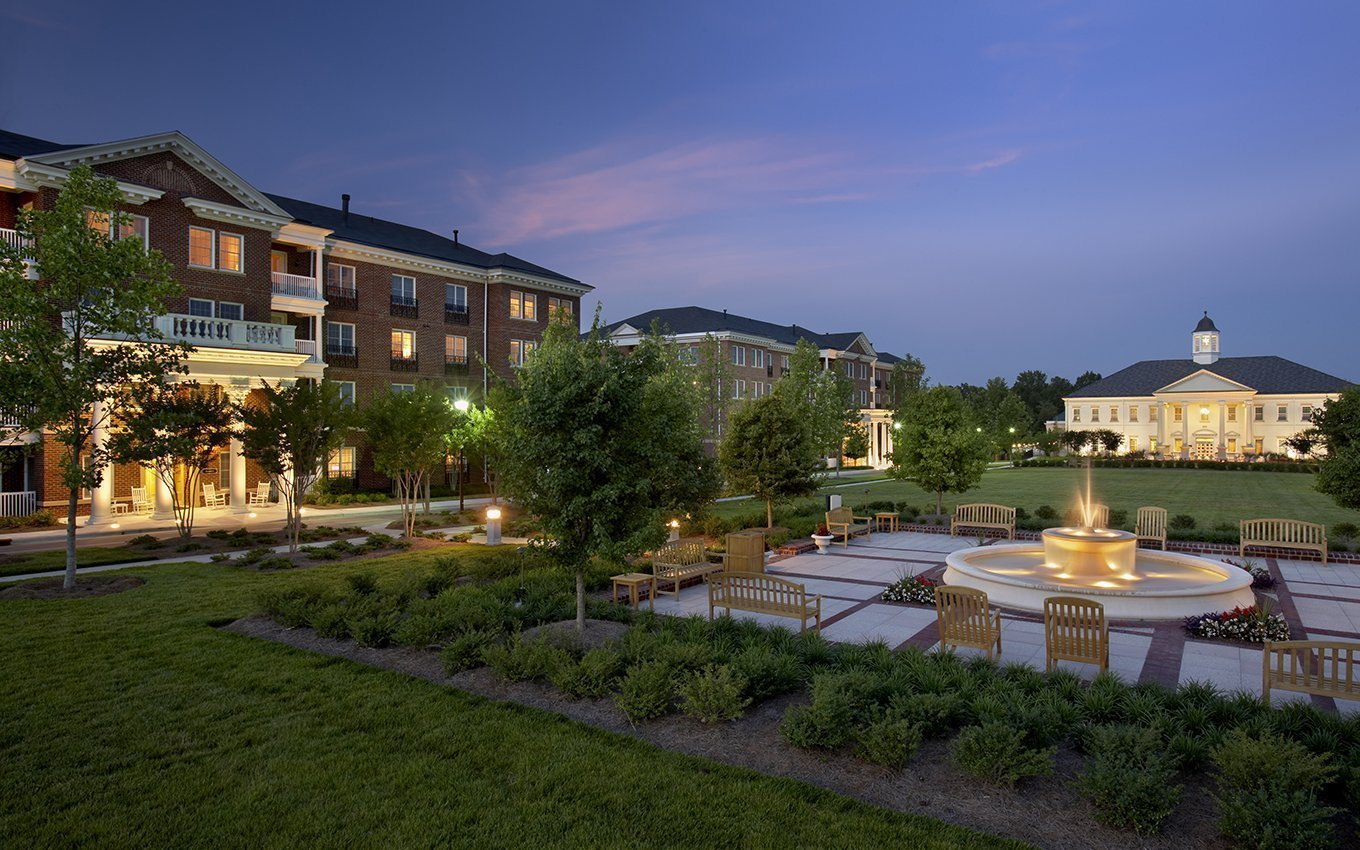 The Cedars of Chapel Hill lawn, fountain, and buildings at twilight