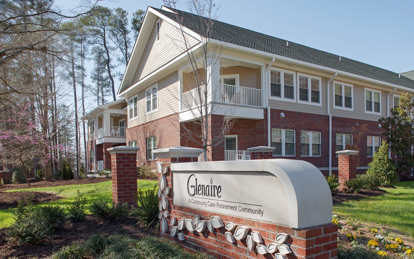 "Glenaire Exterior with Sign ""A Continuing Care Retirement Community"""