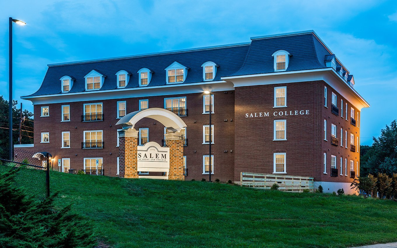 "Salem College McHugh Flats Dorm External view at dusk behind ""Salem Academy and College"" sign"