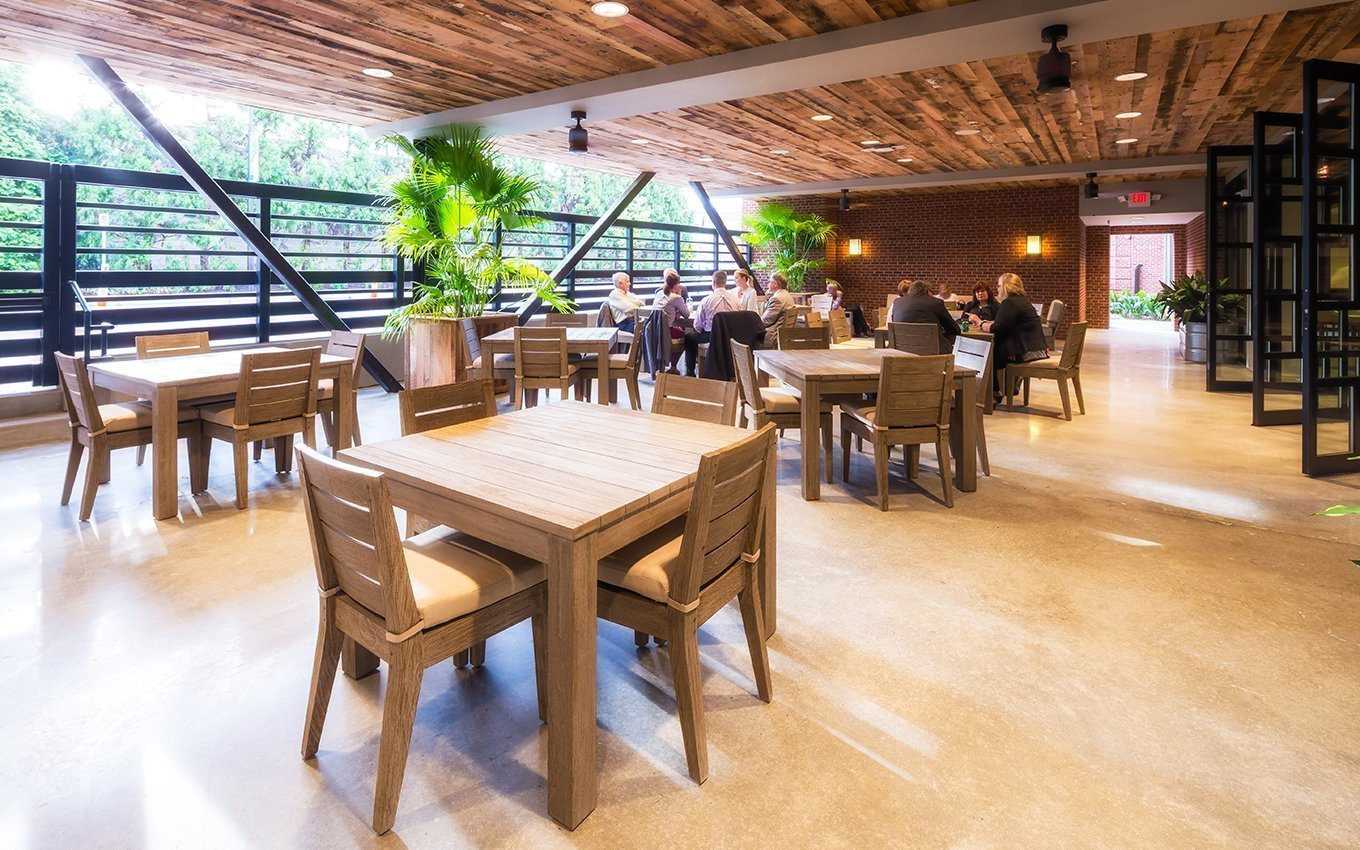 Universal Furniture Dining Area with tables and chairs and open area to outside