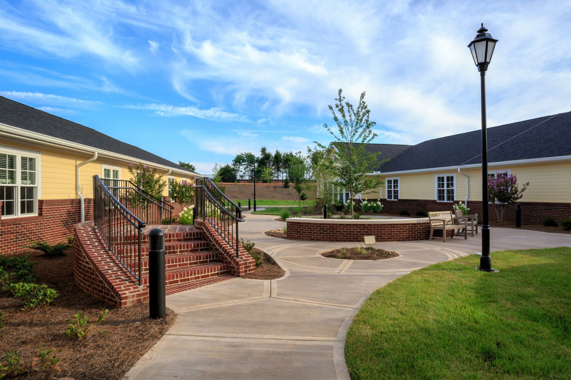 Salemtowne's outdoor courtyard for residents, with walkways and attractive landscaping.